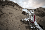Spaceman on a nameless planet, taking rock samples - VPIF00487