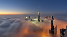 View of the Burj Khalifa and other skyscrapers above the clouds in Dubai, United Arab Emirates. - MINF06518
