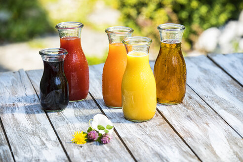 Glass bottles of various fruit juices - MAEF12686