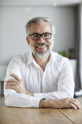 Portrait of smiling mature man at home - RBF06469