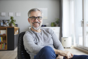 Portrait of content mature man in his living room - RBF06478