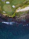 Indonesia, Bali, Aerial view of golf course with bunker and green at coast - KNTF01178