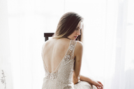 Young woman wearing a wedding dress indoors - AFVF01347