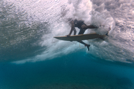 Maledives, Indian Ocean, surfer sitting on surfboard, underwater shot - KNTF01208
