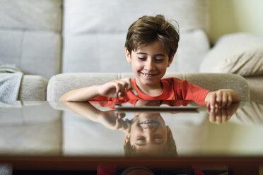 Portrait of little girl using digital tablet at home - JSMF00390