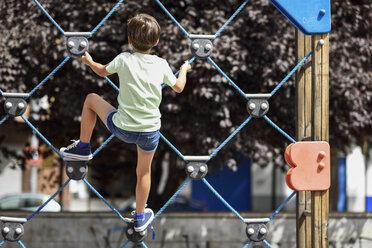Back view of little girl on climbing frame - JSMF00405