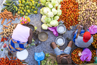 High angle view of vendors selling a selection of fresh vegetables on a street market. - MINF06553