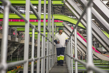 Worker walking through apple factory - ZEF15916
