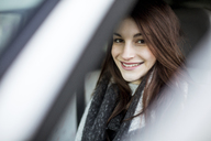 Portrait of smiling young woman driving car in winter - JESF00051