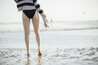 Young woman walking at the beach - JESF00066