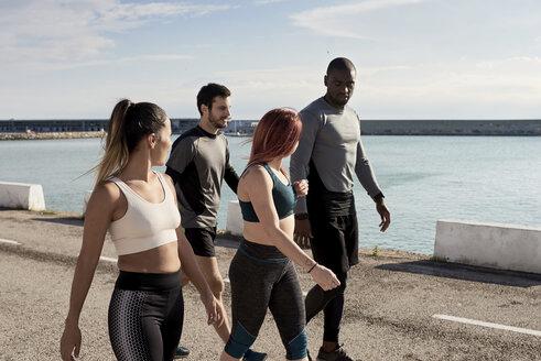 Group of sportspeople walking - JNDF00024