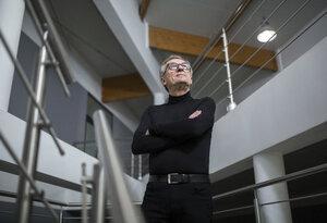Confident senior businessman standing in office hallway - AWF00191