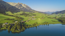 Austria, Tyrol, Kaiserwinkl, Aerial view of lake Walchsee - AIF00540
