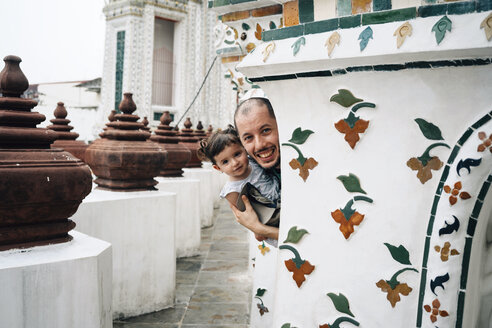 Thailand, Bangkok, Wat Arun, Portrait of happy father and daughter visiting the Buddhist temple - GEM02245