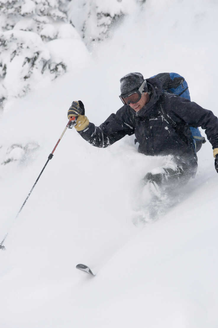 Young Man Skiing In Deep Powder Stockphoto