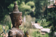 Thailand, Chiang Mai, Buddhist statue in the middle of the jungle in Wat Pha Lat Buddhist temple - GEMF02271