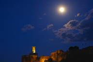 Albania, Gjirokaster, Clock tower of fortress and full moon at night - SIEF07842