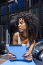 Young woman with tablet in the city - TCF05587