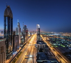 Cityscape of Dubai, United Arab Emirates at dusk, with skyscrapers lining illuminated street. - MINF07522