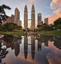 Illuminated Petronas Towers Kuala Lumpur, Malaysia. Reflection in lake. - MINF07597