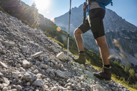 Austria, Tyrol, Young man hiking in the mountains - DIGF04770