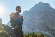 Austria, Tyrol, Hiker with backpack hiking in the mountains - DIGF04773