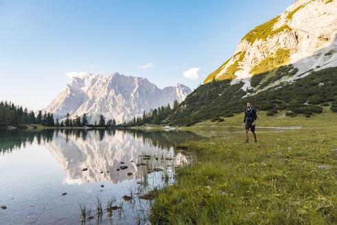 Austria, Tyrol, Hiker with backpack, hiking at Lake Seebensee - DIGF04794