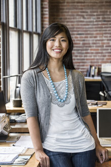 Asian woman at her creative office work station. - MINF07845