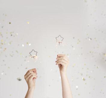 Woman's hands holding sparklers - ABIF00890