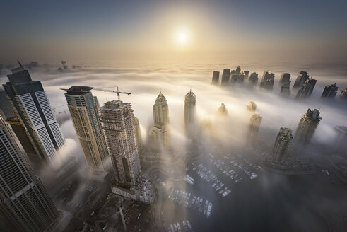 Aerial view of cityscape with skyscrapers above the clouds in Dubai, United Arab Emirates. - MINF08042