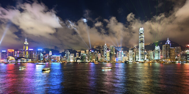 Aerial view of Hong Kong cityscape with illuminated skyscrapers at dusk. - MINF08054