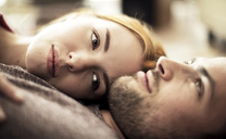 A couple lying together on the floor. - MINF08075
