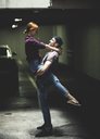 A couple dancing in an underground parking lot. - MINF08084