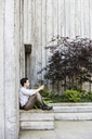 Businessman taking a break in a city park alcove. - MINF08235