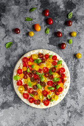 Unbaked pizza with tomatoes and basil leaves - SARF03898