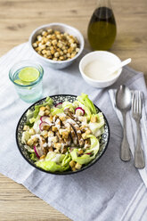 Bowl of Caesar salad with meat and red radish - GIOF04122