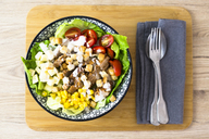 Bowl of Caesar salad with meat, corn and tomatoes - GIOF04128