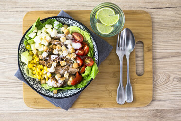 Bowl of Caesar salad with meat, corn and tomatoes - GIOF04131