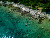 Croatia, Cres, Adriatic Sea, Stand up paddle surfing - DAWF00707