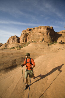Young man hiking in Arches National Park near Moab, Utah. - AURF00271