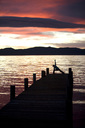 Young woman doing yoga on pier in Tahoe City, CA. - AURF00304