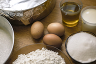 Ingredients for a cake, wheat flower, sugar, milk and eggs on pastry board - ACPF00231