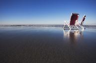 Two beach chairs on wet sand in York, Maine. - AURF00484