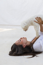 Young woman having fun with dog on roof terrace - AFVF01416