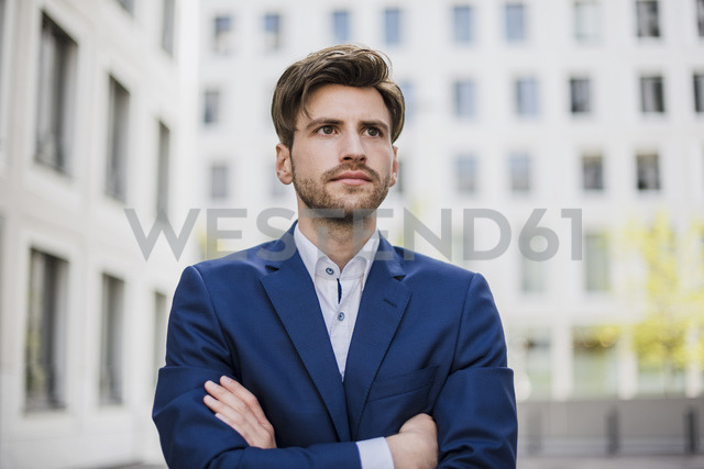 Portrait of serious businessman in the city - DIGF04910