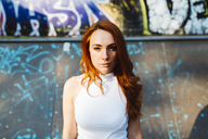 Portrait of redheaded woman at skatepark - GIOF04190