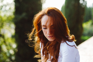 Portrait of redheaded woman at backlight - GIOF04214