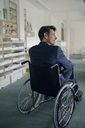 Disabled businessman sitting in wheelchair - GUSF00979