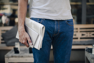 Mature man holding newspaper and digital tablet, mid section - GUSF00982