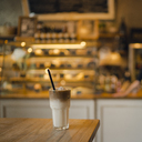 Ice coffee on a table in a coffee shop - GUSF01021